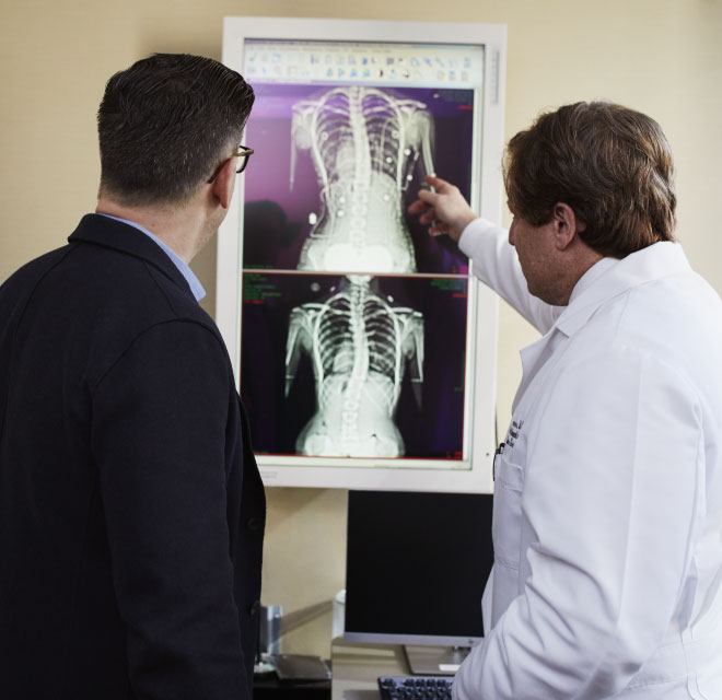 Two doctors looking at x-ray results, Lab and X-Ray Services in Montana