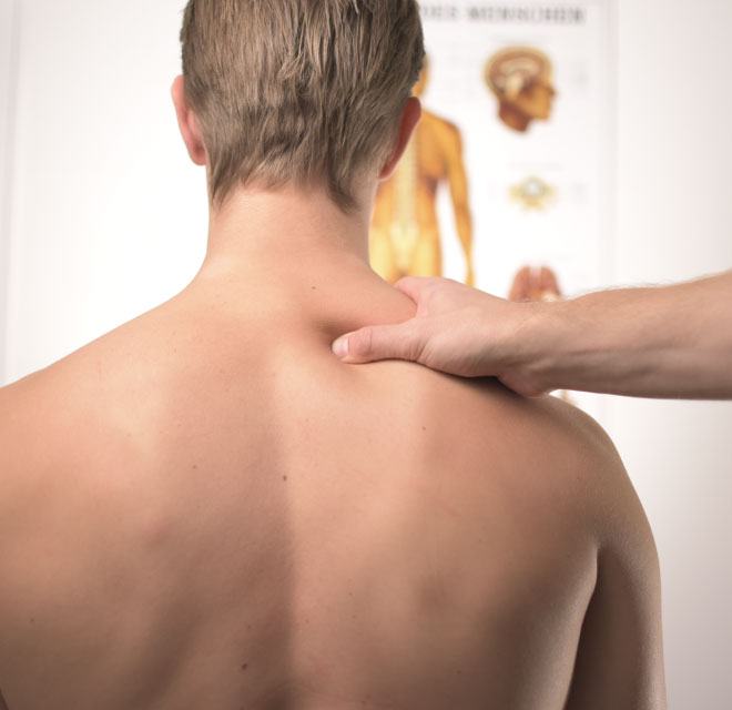 Man getting treatment of shoulder pain, Pain Management in Montana